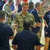 Britain\'s Prince Harry talks with members of the British Warrior Games Team who relaxed in a gymnasium before the opening of 2013 Warrior Games, at the U.S. Olympic Training Center, in Colorado Springs, Colo., Saturday May 11, 2013. (AP Photo/Brennan Linsley, Pool)
