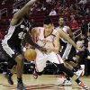 Houston Rockets\' Jeremy Lin (7) tries to drives the ball around San Antonio Spurs\' DeJuan Blair (45) in the first half of an NBA basketball game, Monday, Dec. 10, 2012, in Houston. (AP Photo/Pat Sullivan)