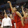 Louisville guard Shoni Schimmel (23) and the Louisville bench react to her 3-point shot against Tennessee in the second half of the regional final in the NCAA women\'s college basketball tournament in Oklahoma City, Tuesday, April 2, 2013. Louisville won 86-78. (AP Photo/Sue Ogrocki)