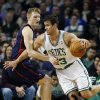 Photo - Boston Celtics' Kris Humphries, right, drives past Detroit Pistons' Kyle Singler, left, in the first quarter of an NBA basketball game in Boston, Sunday, March 9, 2014. (AP Photo/Michael Dwyer)