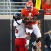 Oklahoma State\'s Isaiah Anderson (82) catches a touchdown pass as Texas Tech\'s Cody Davis (16) defends during a college football game between Oklahoma State University and the Texas Tech University (TTU) at Boone Pickens Stadium in Stillwater, Okla., Saturday, Nov. 17, 2012. Photo by Sarah Phipps, The Oklahoman