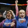 FANS / CROWD / AMELIA SEYS: Anne Seys and her daughter Amelia cheer on the Thunder during the preseason NBA basketball game between the Oklahoma City Thunder and the Phoenix Suns at the Ford Center on Monday, Oct. 12, 2009, in Oklahoma City, Okla. Photo by Chris Landsberger, The Oklahoman. ORG XMIT: KOD