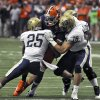 Syracuse\'s Alec Lemon is wrapped up by Pittsburgh\'s Jason Handricks (25), Jarred Holly (18), and Manny Williams during the first quarter of an NCAA college football game in Syracuse, N.Y., Friday, Oct. 5, 2012. (AP Photo/Kevin Rivoli)