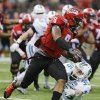 Photo - Louisiana-Lafayette quarterback Terrance Broadway (8) gets around Tulane safety Sam Scofield (35) during the second half of the New Orleans Bowl NCAA college football game, Saturday, Dec. 21, 2013, in New Orleans. (AP Photo/Bill Haber)