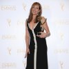 """Photo - Allison Janney poses in the press room with the award for outstanding guest actress in a drama series for her work on """"Masters of Sex"""" at the 2014 Creative Arts Emmys at Nokia Theatre L.A. LIVE on Saturday, Aug. 16, 2014, in Los Angeles. (Photo by Richard Shotwell/Invision/AP)"""