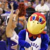 KU COLLEGE BASKETBALL: University of Kansas Jayhawk mascot and cheerleader perform during a timeout against Bucknell in the first round of the NCAA Tournament at the Ford Center in Oklahoma City, Friday, March 18, 2005. By Nate Billings/The Oklahoman.