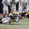 Clinton\'s Devon Mitchell is tripped up by Catoosa\'s Damontre Wallace during the high school Class 4A playoff game between Clinton and Catoosa at Putnam City High School., Friday, Nov. 25, 2011. Photo by Sarah Phipps, The Oklahoman