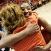 OSU\'s Tiffany Bias (3) hugs Shelley Budke, widow of OSU head coach Kurt Budke, after the Women\'s NIT championship college basketball game between Oklahoma State University and James Madison at Gallagher-Iba Arena in Stillwater, Okla., Saturday, March 31, 2012. Kurt Budke and three others were killed in a plane crash on a recruiting trip in November of 2011. OSU won, 75-68. Photo by Nate Billings, The Oklahoman