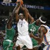 Oklahoma City\'s Joe Smith, middle, tries to grab a rebound between Boston\'s Kevin Garnett, left, and Kendrick Perkins as Oklahoma City\'s Chris Wilcox looks on in the first half during the NBA basketball game between the Oklahoma City Thunder and the Boston Celtics at the Ford Center in Oklahoma City, Wednesday, Nov. 5, 2008. BY NATE BILLINGS, THE OKLAHOMAN