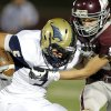 Edmond Memorial\'s Tasden Ingram tackles Southmoore\'s Jackson Stallings during the high school football game between Edmond Memorial and Southmoore at Wantland Stadium in Edmond, Okla., Friday, Oct. 19, 2012. Photo by Sarah Phipps, The Oklahoman