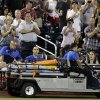 Atlanta Braves\' Tim Hudson is carted off the field after being injured during the eighth inning of a baseball game against the New York Mets, Wednesday, July 24, 2013, in New York. (AP Photo/Frank Franklin II)