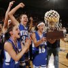 The Vinita Lady Hornets celebrate with the championship trophy after the Class 4A girls championship game between Vinita and Cache in the Oklahoma High School Basketball Championships at State Fair Arena in Oklahoma City, Saturday, March 14, 2009. Vinita won, 51-45. PHOTO BY NATE BILLINGS, THE OKLAHOMAN