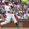 St. Louis Cardinals\' Carlos Beltran hits an RBI-double during the first inning of a baseball game against the Texas Rangers, Friday, June 21, 2013, in St. Louis. (AP Photo/Jeff Roberson)