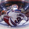 Photo - In this photo taken with a fisheye lens, New York Rangers goalie Henrik Lundqvist stops a shot against the Philadelphia Flyers in the second period in Game 3 of an NHL hockey first-round playoff series, Tuesday, April 22, 2014, in Philadelphia. (AP Photo/Chris Szagola)