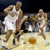 Oklahoma City\'s Russell Westbrook, left, and Michael Ruffin fight for the ball beside Miami\'s Udonis Haslem during an NBA preseason game between the Oklahoma City Thunder and the Miami Heat at the BOK Center in Tulsa, Okla., Wednesday, October 14, 2009. Photo by Bryan Terry, The Oklahoman