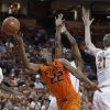 Oklahoma State\'s Markel Brown (22) shoots through Texas defenders Jaylen Bond (5), Connor Lammert (21) and Julien Lewis, center, during the second half of an NCAA college basketball game, Saturday, Feb. 9, 2013, in Austin, Texas. Oklahoma State won 72-59. (AP Photo/Eric Gay) ORG XMIT: TXEG106