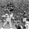 COLLEGE FOOTBALL: (3/6) University of Oklahoma (OU) running back Joe Washington leaps over a Utah State player for a touchdown in Norman, Okla., September 28, 1974. By Jim Argo/The Oklahoman. This is the third in a series of six.