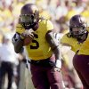 Photo -   Minnesota quarterback MarQueis Gray (5) runs against Western Michigan during the first half of an NCAA college football game, Saturday, Sept. 15, 2012, in Minneapolis. (AP Photo/Paul Battaglia)