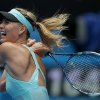 Photo - Maria Sharapova of Russia hits a backhand return to Alize Cornet of France during their third round match at the Australian Open tennis championship in Melbourne, Australia, Saturday, Jan. 18, 2014.(AP Photo/Aaron Favila)