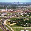 Aerial view, Tornado aftermath: Aerial View looking northwest with traffic on Interstate 35. The overpass at left center is N. E. 12th street
