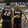 Miami Heat\'s Udonis Haslem (40) celebrates with Chris Bosh (1) after Haslem made a shot and was fouled during the first half of Game 3 of the NBA Eastern Conference basketball finals against the Indiana Pacers in Indianapolis, Sunday, May 26, 2013. (AP Photo/Nam H. Huh)