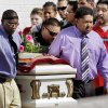 Pallbearers carry the casket of Rosalin Reynolds, 8, from her funeral service Thursday at the Watonga High School gym to a hearse. Rosalin was found fatally stabbed in Watonga last week. JIM BECKEL - The Oklahoman