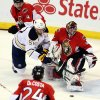 Buffalo Sabres\' Tylers Myers (57) attempts to reach the puck as Ottawa Senators goaltender Craig Anderson (41) covers the net during the first period of their NHL hockey game, Tuesday, Feb. 12, 2013, in Ottawa, Ontario. (AP Photo/The Canadian Press, Fred Chartrand)