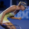 Russia\'s Maria Sharapova reacts during her third round match against Venus Williams of the US at the Australian Open tennis championship in Melbourne, Australia, Friday, Jan. 18, 2013. (AP Photo/Dita Alangkara)