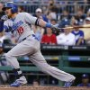Photo - Los Angeles Dodgers' Justin Turner (10) drives in two runs with a double off Pittsburgh Pirates starting pitcher Edinson Volquez during the fourth inning of a baseball game in Pittsburgh Monday, July 21, 2014. (AP Photo/Gene J. Puskar)