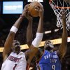 Oklahoma City\'s Serge Ibaka (9) goes for the ball beside Miami\'s Chris Bosh (1) during Game 3 of the NBA Finals between the Oklahoma City Thunder and the Miami Heat at American Airlines Arena, Sunday, June 17, 2012. Photo by Bryan Terry, The Oklahoman