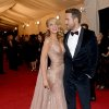 """Blake Lively, left, and Ryan Reynolds attend The Metropolitan Museum of Art\'s Costume Institute benefit gala celebrating """"Charles James: Beyond Fashion"""" on Monday, May 5, 2014, in New York. (Photo by Evan Agostini/Invision/AP)"""