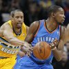 Photo - Denver Nuggets guard Andre Miller, left, reaches in for the ball and is called for a foul against Oklahoma City Thunder forward Kevin Durant in overtime of an NBA basketball game in Denver on Sunday, Jan. 20, 2013. The Nuggets won 121-118 in overtime. (AP Photo/David Zalubowski) ORG XMIT: CODZ111