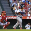St. Louis Cardinals\' Jon Jay watches his two-run home run in front of Los Angeles Angels catcher Hank Conger during the second inning of a baseball game, Wednesday, July 3, 2013, in Anaheim, Calif. (AP Photo/Mark J. Terrill)