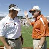 Photo - Bob Stoops, left, and Mack Brown are two of the biggest stars in the Big 12 for 2010. PHOTO BY STEVE SISNEY, THE OKLAHOMAN ARCHIVE