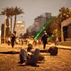 In this Monday, Jan. 28, 2013 photo, an Egyptian protester takes a break while others use green laser pointers during clashes between protesters and Egyptian security forces in Downtown Cairo, Egypt. On Tuesday, Jan. 29, 2013, Egypt\'s army chief warned of