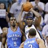 Memphis Grizzlies forward Zach Randolph, top right, looks for a teammate as he is defended by Oklahoma City Thunder forward Serge Ibaka (9) and Thabo Sefolosha (2), of Switzerland, during the first half of Game 6 of a second-round NBA basketball playoff series on Friday, May 13, 2011, in Memphis, Tenn. (AP Photo/Lance Murphey)