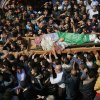 Palestinian mourners carry the body of Hamas\' top military commander Ahmed Jabari, killed in an Israeli strike on Wednesday, during his funeral in Gaza City, Thursday, Nov. 15, 2012. (AP Photo/Adel Hana)