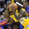 Denver Nuggets guard Ty Lawson (3) scoops up a loose ball against Detroit Pistons forward Jason Maxiell (54) during the first quarter of an NBA basketball game, Tuesday, Nov. 6, 2012, in Denver. (AP Photo/Jack Dempsey)