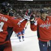 Photo - Washington Capitals right wing Alex Ovechkin (8), of Russia, celebrates his goal with John Carlson against the New York Islanders during the second period an NHL hockey game, Tuesday, Nov. 5, 2013, in Washington. (AP Photo/Nick Wass)