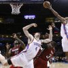 Oklahoma City\'s Russell Westbrook (0) shoots a lay up as Oklahoma City\'s Nick Collison (4) Miami\'s Joel Anthony (50) and Miami\'s Dwyane Wade (3) position for a rebound during the NBA basketball game between Oklahoma City and Miami at the OKC Arena in Oklahoma City, Thursday, Jan. 30, 2011. Photo by Sarah Phipps, The Oklahoman