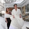 Bride Kathryn Jussaume with her sister and maid of honor Adrianne Richard, left, pose in snowshoes as Adrianne\'s husband takes a photo in front of her parents\' house before going to her wedding, Saturday, Feb. 9, 2013 in Lowell, Mass. A howling storm across the Northeast left the New York-to-Boston corridor shrouded in 1 to 3 feet of snow Saturday, stranding motorists on highways overnight and piling up drifts so high that some homeowners couldn\'t get their doors open. More than 650,000 homes and businesses were left without electricity. (AP Photo/The Lowell Sun, Julia Malakie)