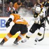 Photo - Boston Bruins' David Krejci, right, of Czech Republic makes a move with the puck against Philadelphia Flyers' Nicklas Grossmann, left, of Sweden during the first period of an NHL hockey game, Saturday, Jan. 25, 2014, in Philadelphia.  (AP Photo/Chris Szagola)