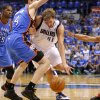 Dallas\' Dirk Nowitzki (41) tries to get between Oklahoma City\'s Kevin Durant (35), Nick Collison (4), and Russell Westbrook (0) during Game 4 of the first round in the NBA playoffs between the Oklahoma City Thunder and the Dallas Mavericks at American Airlines Center in Dallas, Saturday, May 5, 2012. Oklahoma City won 103-97. Photo by Bryan Terry, The Oklahoman
