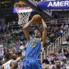 New Orleans Hornets\' Anthony Davis (23) goes to the basket as Utah Jazz\'s Paul Millsap (24) and Marvin Williams (2) watch in the first quarter during an NBA basketball game Wednesday, Jan. 30, 2013, in Salt Lake City. (AP Photo/Rick Bowmer)