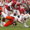 Oklahoma\'s Curtis Lofton (40) takes down Oklahoma State quarterback Zac Robinson (11) causing a fumble during the first half of the college football game between the University of Oklahoma Sooners (OU) and the Oklahoma State University Cowboys (OSU) at the Gaylord Family-Memorial Stadium on Saturday, Nov. 24, 2007, in Norman, Okla. Photo By CHRIS LANDSBERGER, The Oklahoman