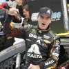 Photo - Jeff Gordon celebrates his victory after the NASCAR Sprint Cup Series Pure Michigan 400 auto race at Michigan International Speedway in Brooklyn, Mich., Sunday, Aug. 17, 2014. (AP Photo/Bob Brodbeck)