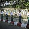 Young boys and girls line the streets waving flags along the motorcade route in anticipation of the arrival of U.S. President Barack Obama, in Yangon, Myanmar, Monday, Nov. 19, 2012. (AP Photo/Pablo Martinez Monsivais)