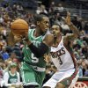 Photo -   Boston Celtics' Rajon Rondo (9) drives to the basket as Milwaukee Bucks' Brandon Jennings (3) defends during the first half of an NBA basketball game, Saturday, Nov. 10, 2012, in Milwaukee. (AP Photo/Jim Prisching)