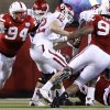 Nebraska\'s Jared Crick (94) and Barry Turner (99) sack Oklahoma\'s Landry Jones (12) during the first half of the college football game between the University of Oklahoma Sooners (OU) and the University of Nebraska Cornhuskers (NU) on Saturday, Nov. 7, 2009, in Lincoln, Neb. Photo by Chris Landsberger, The Oklahoman