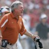 Photo - REACTION / OU: University of Texas coach Mack Brown reacts in the second quarter of an NCAA college football game against University of Oklahoma, Saturday, Oct. 11, 2008, in Dallas. (AP Photo/Tony Gutierrez) ORG XMIT: DNB110